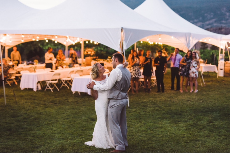 Wedding party on the lawn with a tent at see ya later ranch in okanagan falls